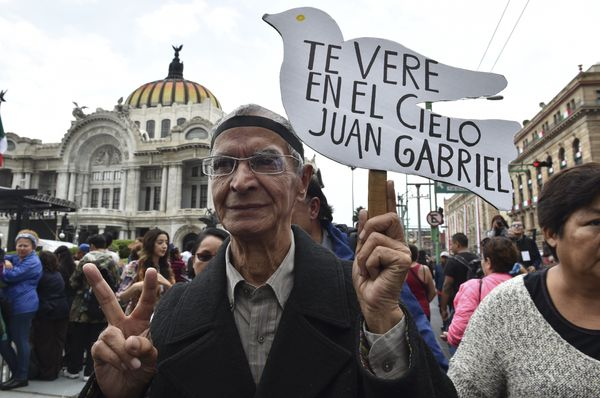 "This fan's sign reads ""I'll see you in heaven, Juan Gabriel."""