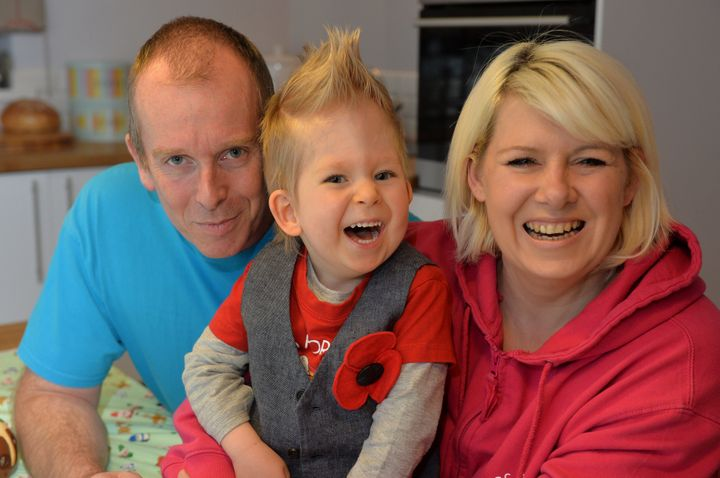 Noah Wall aged two with his parents.