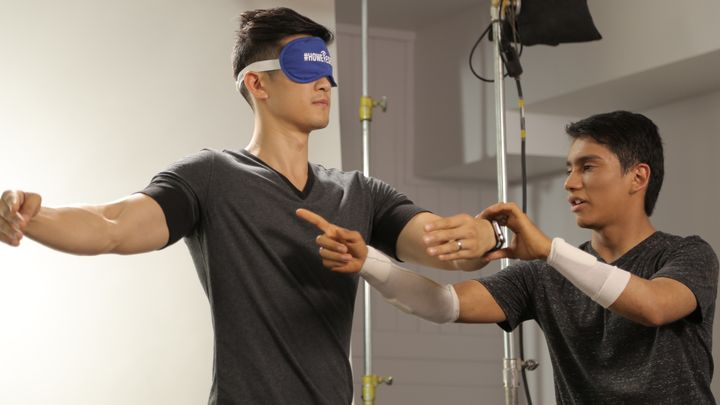 Benjamin Yonattan teaching Harry Shum, Jr. how to dance without sight.