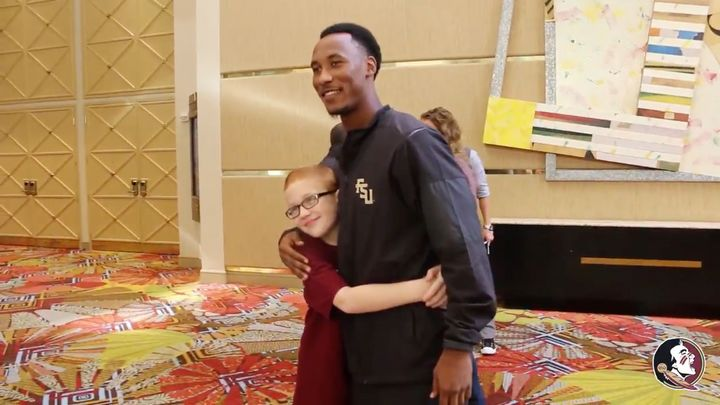 FSU football player Travis Rudolph is seen embracing Bo Paske during their emotional reunion on Sunday.
