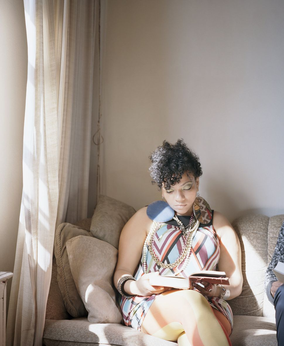 "Abigail reads Angela Davis' <i>An Autobiography,</i> 1974, in Carrie Schneider's series ""Reading Women."" (Image courtesy"