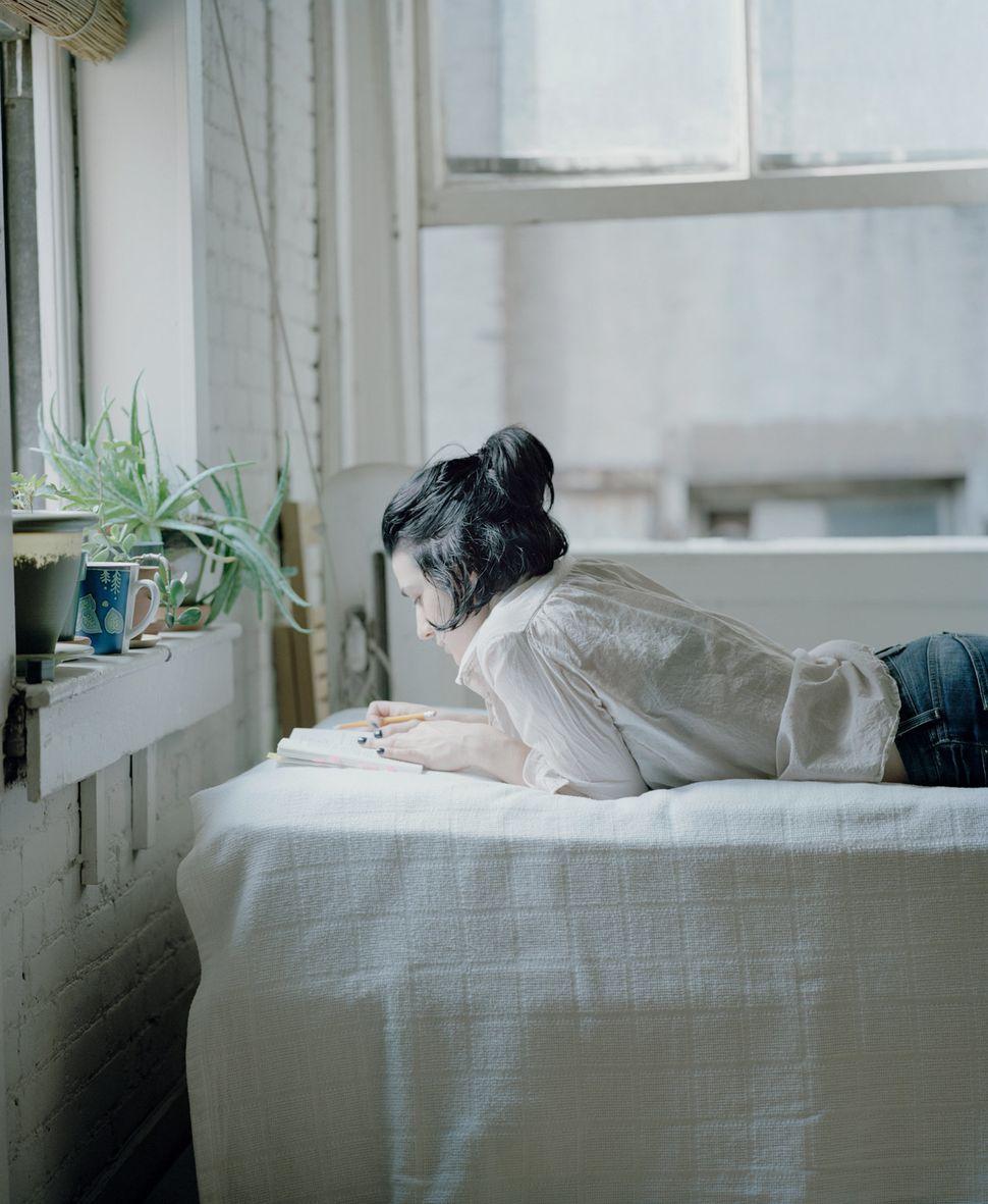"Vicky reads&nbsp;Gloria Fuertes' <i>Historia de Gloria Amor Humor y Desamor,</i> 1980, in&nbsp;Carrie Schneider's series ""Rea"