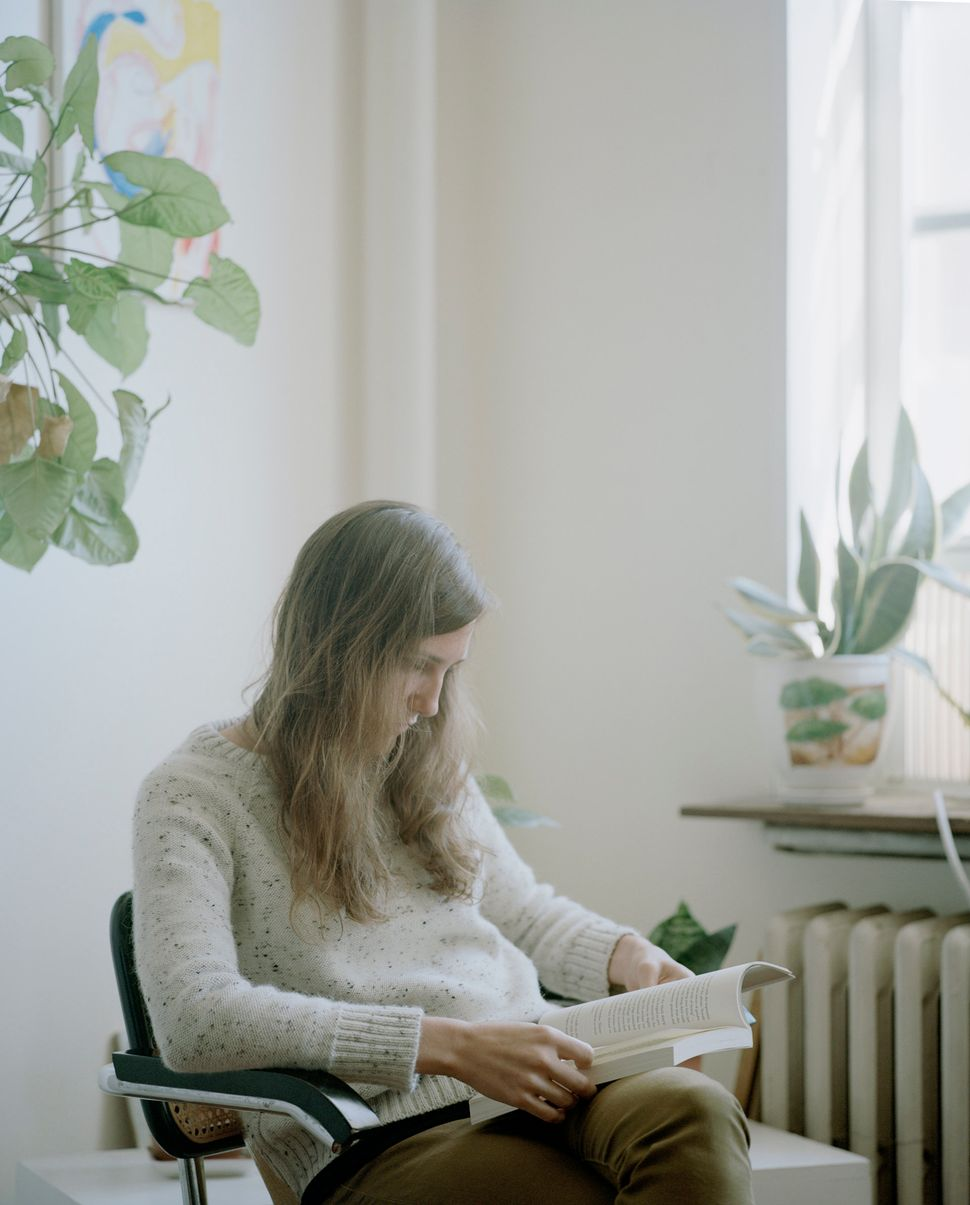 "Heather reads Chris Kraus' <i>Summer of Hate,</i> 2012, in Carrie Schneider's series ""Reading Women."" (Image courte"