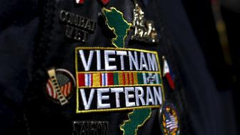 A Vietnam veteran wears patches and pins on his jacket as he attends the USS Midway's ceremony commemorating the 40th Anniversary of Operation Frequent Wind and the fall of Saigon in San Diego, California, United States April 26, 2015.  REUTERS/Mike Blake
