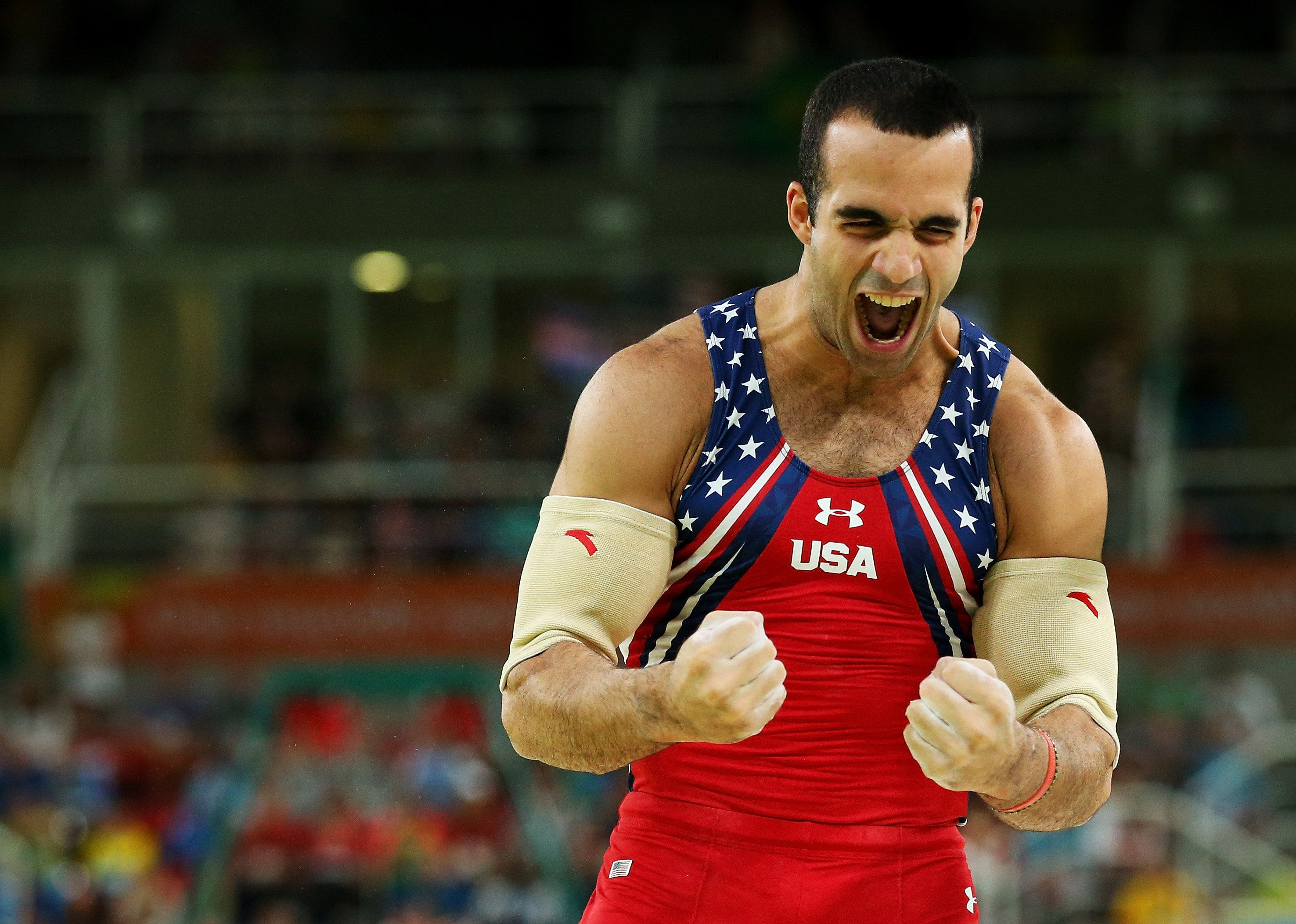 RIO DE JANEIRO, BRAZIL - AUGUST 08:  Danell Leyva of the United States celebrates after competing the parallel bars during the men's team final on Day 3 of the Rio 2016 Olympic Games at the Rio Olympic Arena on August 8, 2016 in Rio de Janeiro, Brazil.  (Photo by Alex Livesey/Getty Images)