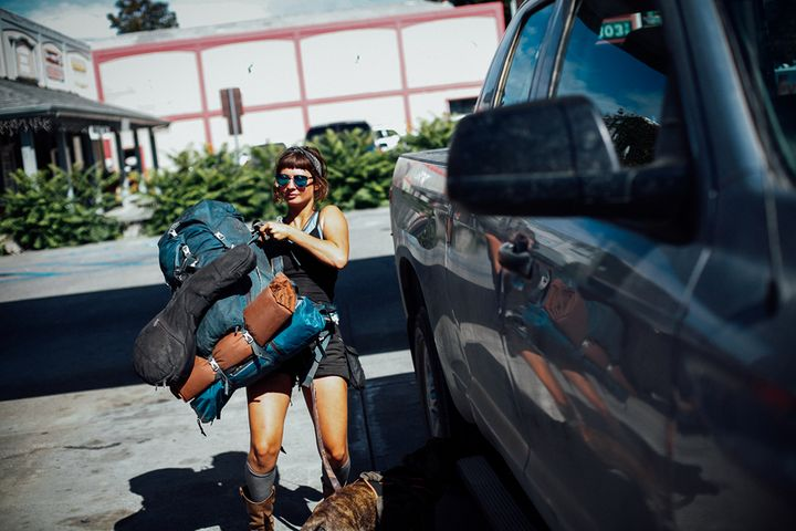Emily Rothman of Florida throws her pack into a truck that will take her to a friend's pot farm in Garberville, Calif.