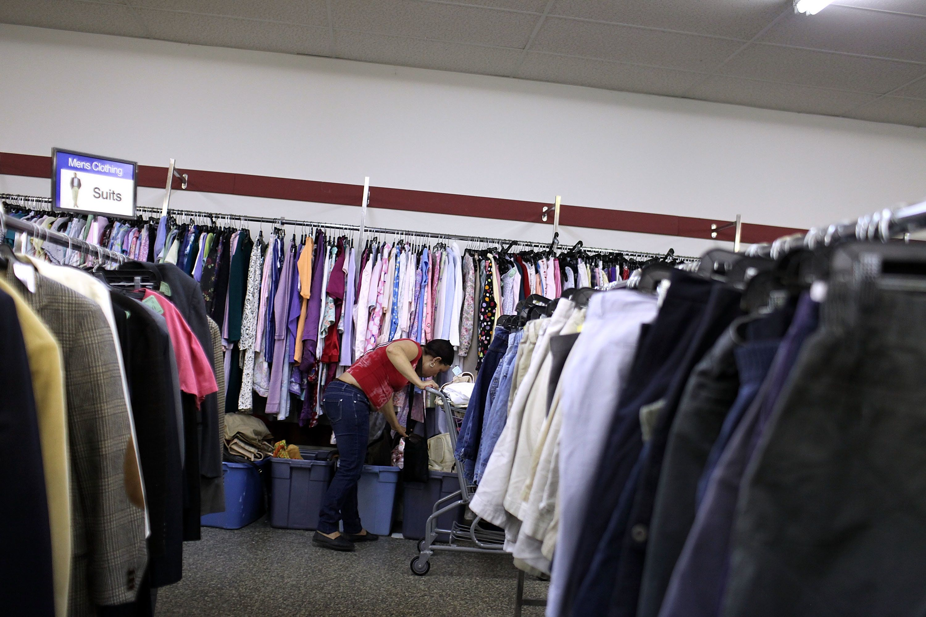 A woman shops at a Salvation Army thrift store in Utica, New York. Online clothing resale outlets like ThredUP hope to offer