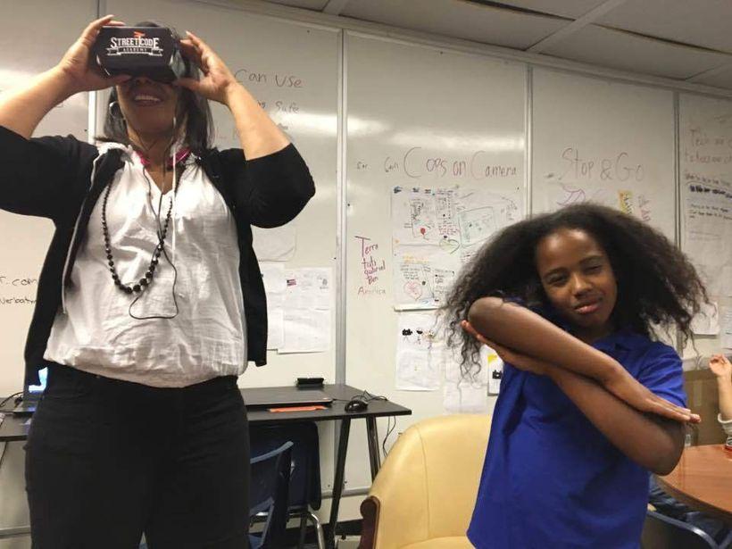 <i>EPA Councilmember&nbsp;Lisa Gauthier enjoying Tati Sobomehin's VR project on her family.&nbsp;</i>