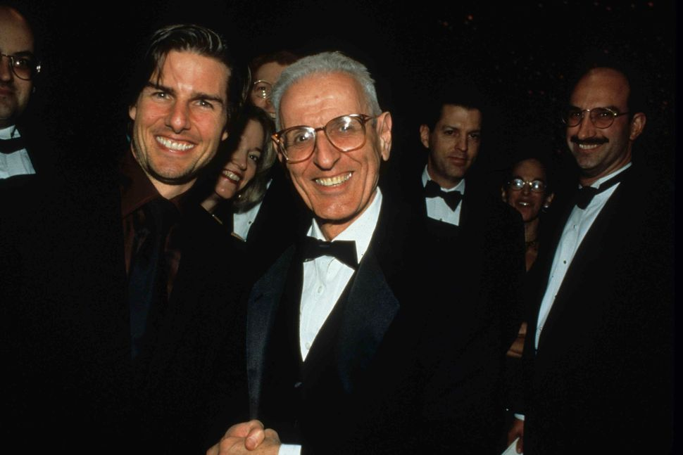 Tom Cruise meeting Dr. Kevorkian at the Time magazine 75th anniversary party in 1995. (Photographed by McMullan and provided