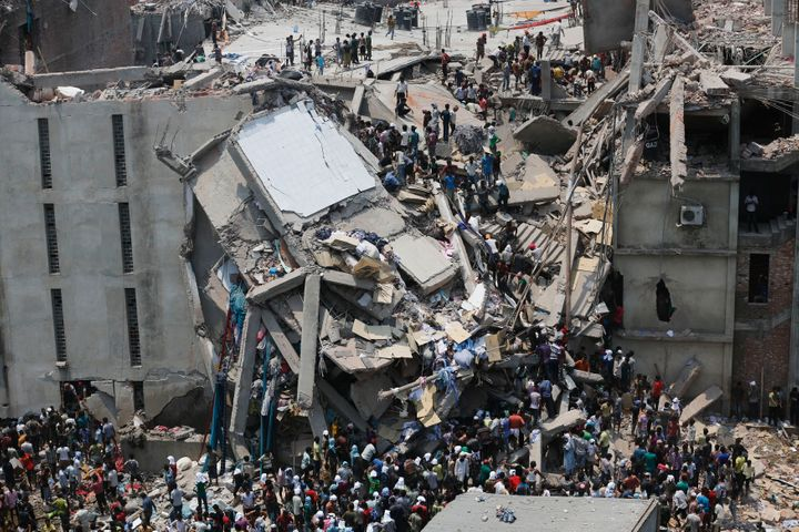 People rescue garment workers trapped under rubble at the Rana Plaza building after it collapsed April 24, 2013.