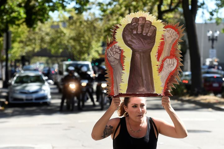 Aprotester holds a sign during a Black Lives Matter protest in Oakland, California.