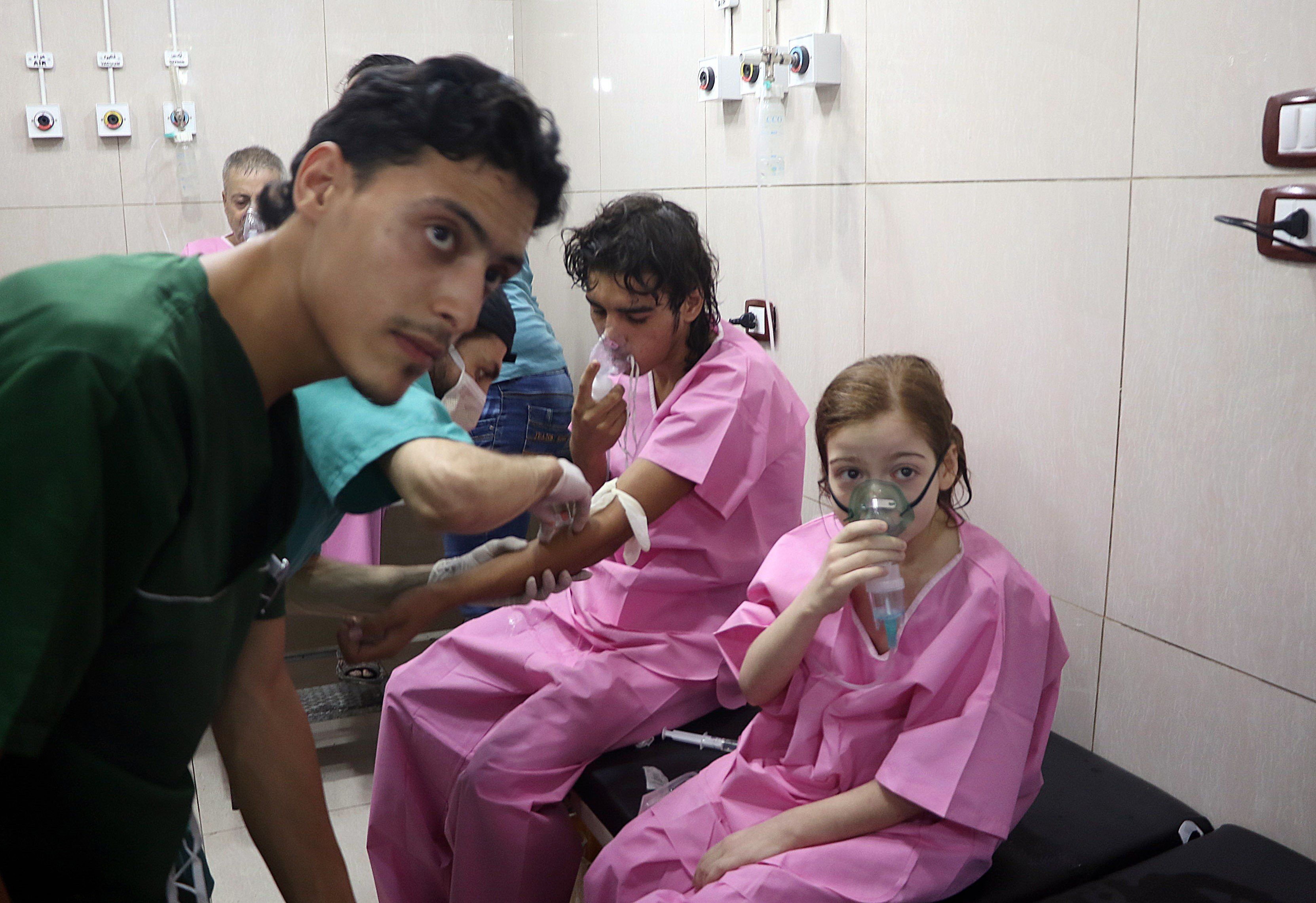 ALEPPO, SYRIA - SEPTEMBER 6: Civilians receive medical treatment at Sahara Hospital after a helicopter belonging to the Assad regime forces carried out a barrel bomb attack over residential areas at opposition controlled Sukkeri region of Aleppo, Syria on September 6, 2016. According to the local report's claims, barrel bomb used in the attack contains chlorine war gas. (Photo by Ibrahim Ebu Leys/Anadolu Agency/Getty Images)