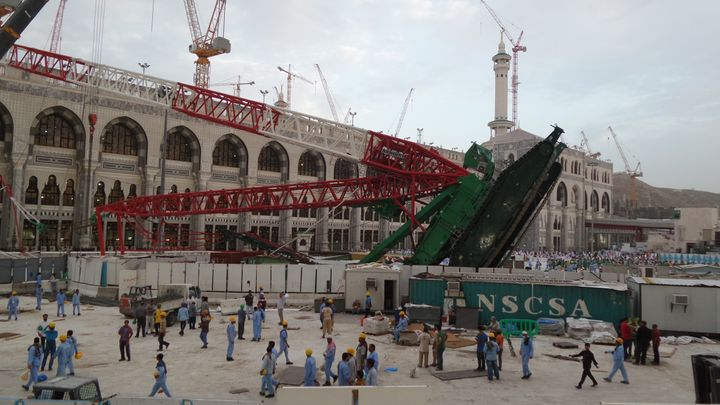 A huge construction crane buffeted by strong winds collapsed and crashed through the roof of the Grand Mosque which surrounds