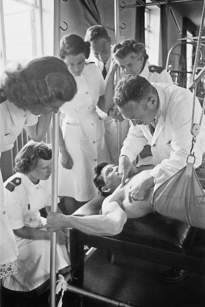 Ludwig Guttmann instructing a group of physiotherapists at the National Spinal Injuries Centre at Stoke Mandeville Hospital i