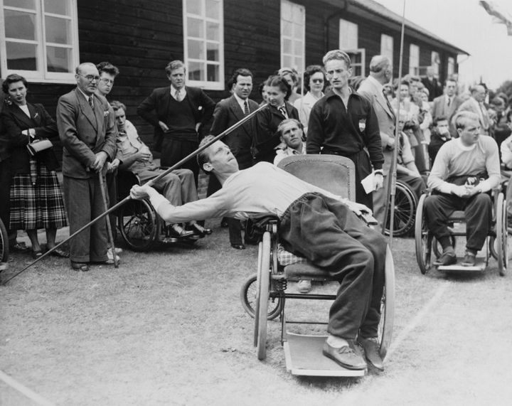 Joep de Beer of Doorn, Holland, leans into the javelin from his wheelchair during the Stoke Mandeville Games for paraplegic c