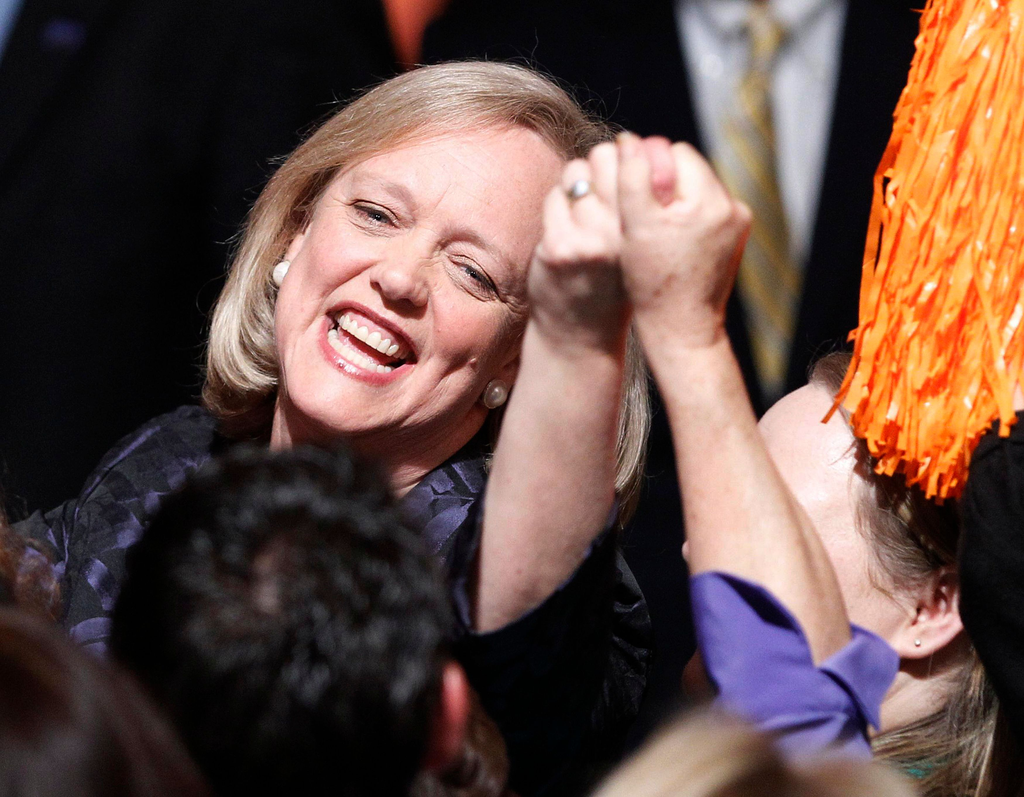 California Republican gubernatorial candidate Meg Whitman reaches out to a supporter during her election night rally in Los Angeles, California, November 2, 2010.     REUTERS/Lucy Nicholson (UNITED STATES - Tags: ELECTIONS POLITICS)