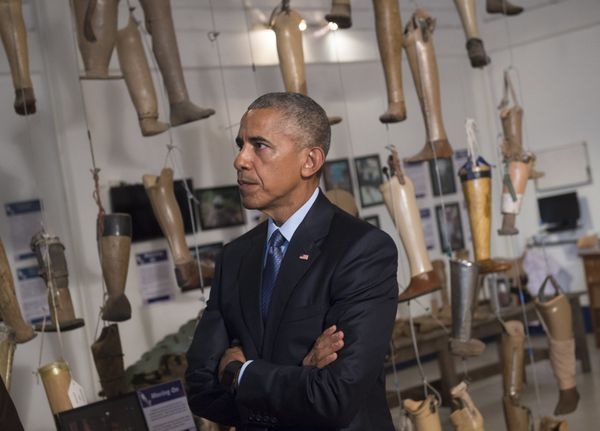 Obama tours the Cooperative Orthotic and Prosthetic Enterprise visitor center in Vientiane.