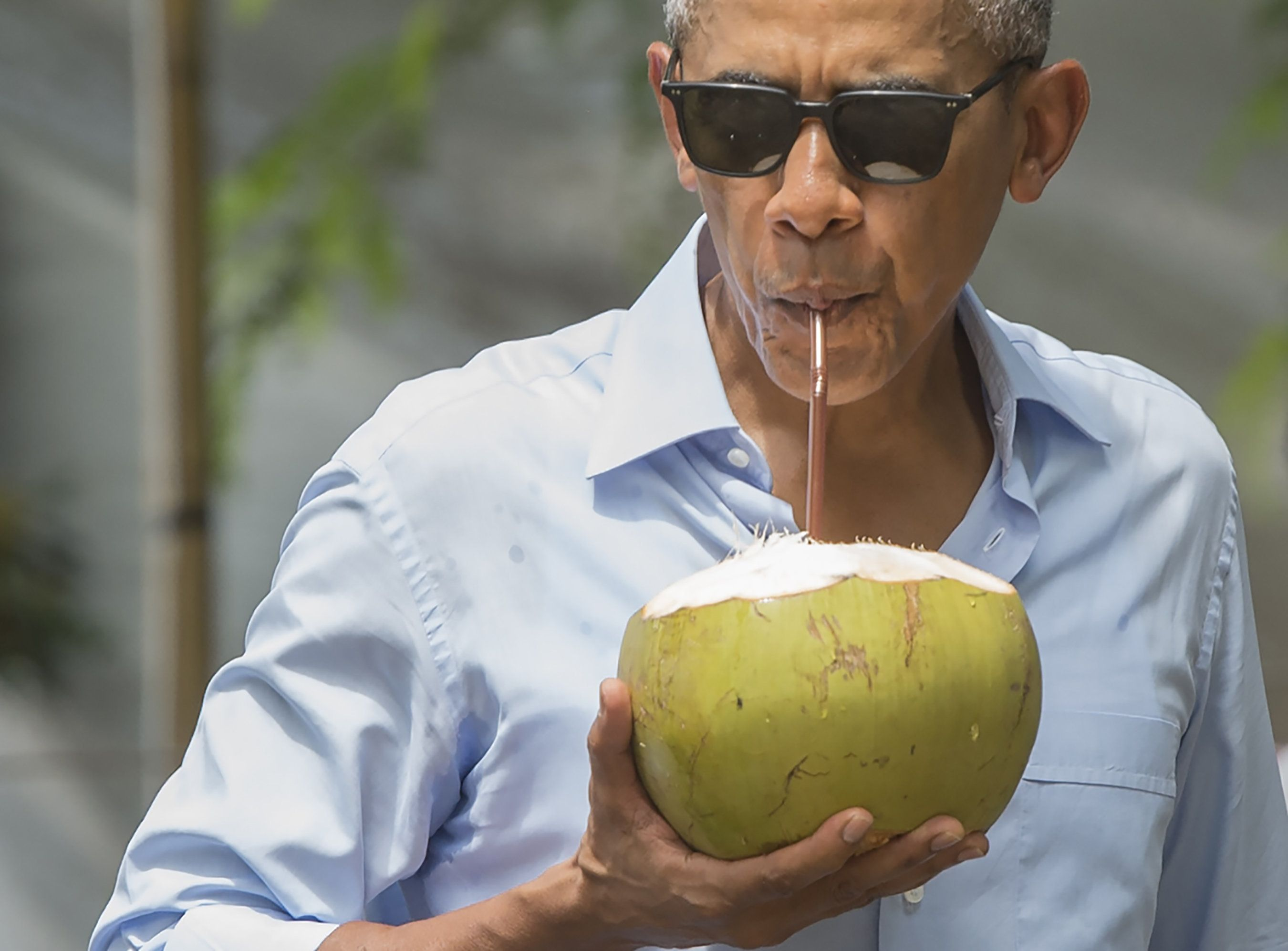 US President Barack Obama drinks from a coconut as he makes a surprise stop for a drink alonside the Mekong River in Luang Prabang on September 7, 2016. Obama became the first US president to visit Laos in office, touching down in Vientiane late on September 5 for a summit of East and South East Asian leaders. / AFP / SAUL LOEB        (Photo credit should read SAUL LOEB/AFP/Getty Images)