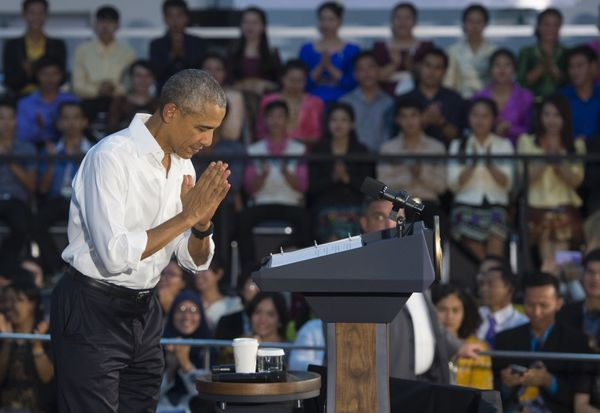 Obama bows as he arrives to hold a YSEALI town hall meeting at Souphanouvong University Auditorium in Luang Prabang.