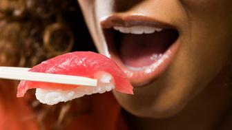 Woman eating nigiri sushi