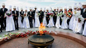 Kyrgyz brides and grooms lay flowers at the Eternal Flame before a mass wedding ceremony May 7 2011 Some estimates say up to half of marriages in Kyrgyzstan are results of bride kidnapping with a third of those nonconsensual