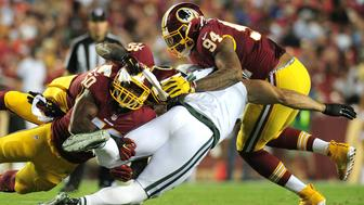 Aug 19, 2016; Landover, MD, USA; New York Jets tight end Kellen Davis (47) fumbles on a hit by Washington Redskins linebacker Perry Riley Jr. (56), linebacker Martrell Spaight (50) and linebacker Preston Smith (94) in the second quarter at FedEx Field. Mandatory Credit: Evan Habeeb-USA TODAY Sports