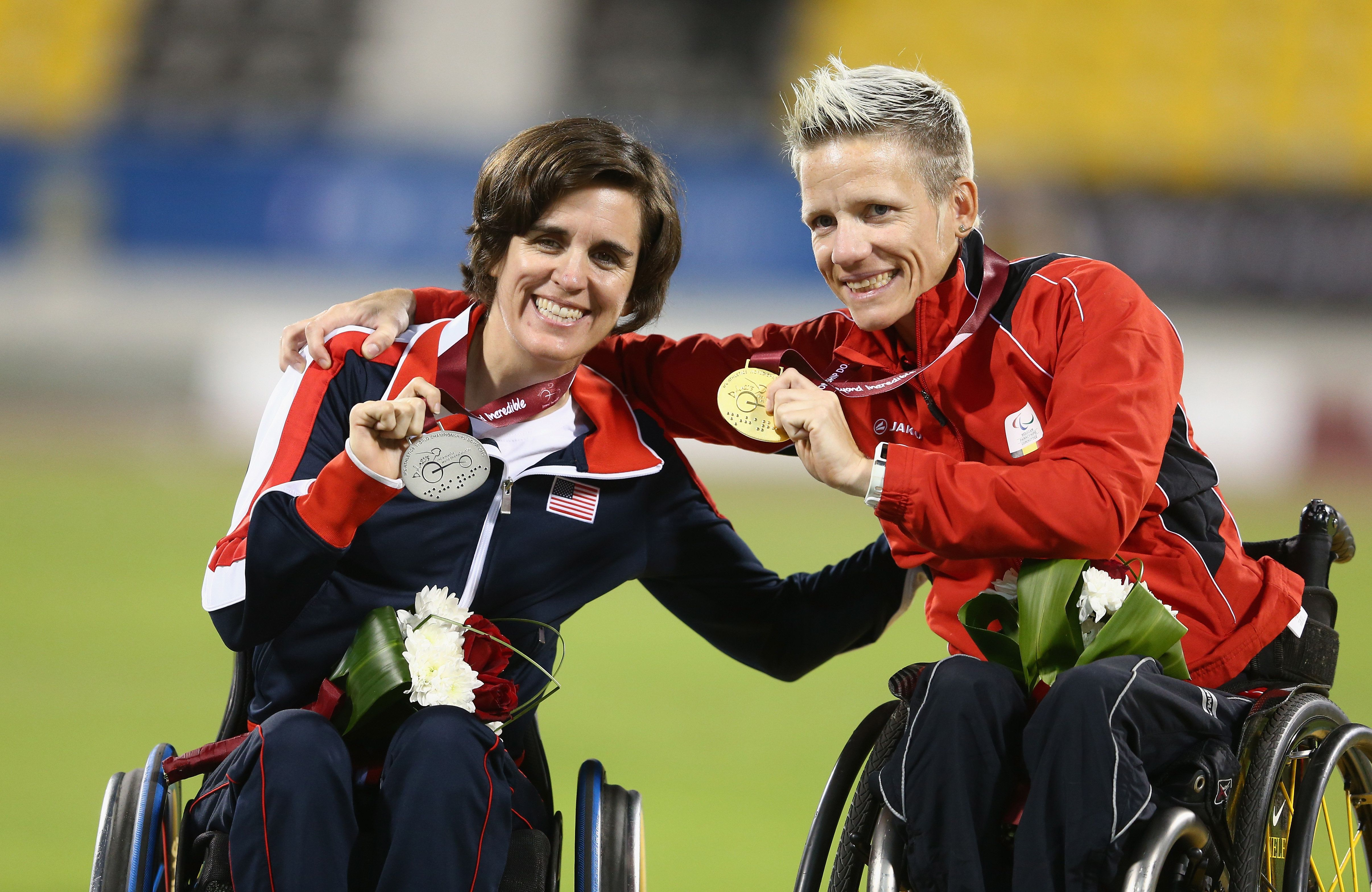 Marieke Vervoort of Belgium (right) celebrates her gold with Kerry Morgan of USA (left) and her silver in the women's 400m T5