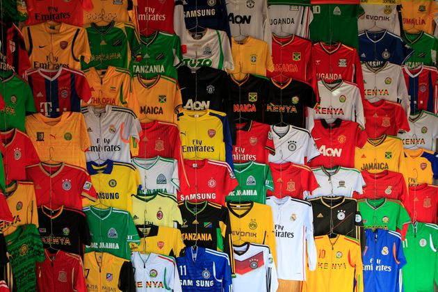 Secondhand sport jerseys are displayed at a stall in the busy Gikomba market in Nairobi, Sept. 24,