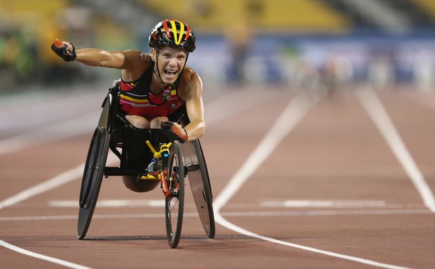 Marieke Vervoort of Belgium celebrates winning the women's 200m T52 final duringthe IPC Athletics...