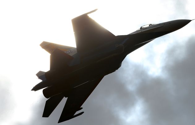 ARussian fighter jetperforms atan air show. ARussian Sukhoi Su-27 fighter jet...