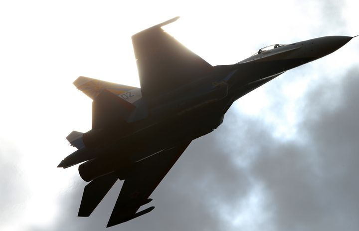 ARussian fighter jetperforms atan air show. ARussian Sukhoi Su-27 fighter jet came within 10 feet of