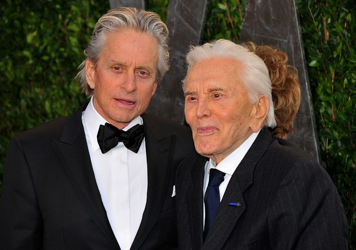 Michael and Kirk Douglas arrive at the 2012 Vanity Fair Oscar Party in Los Angeles.