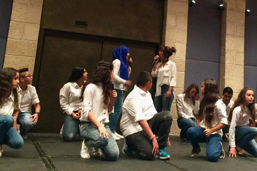 """In Jerusalem, two choirs of teenagers sing """"Not Everything is from Allah"""""""
