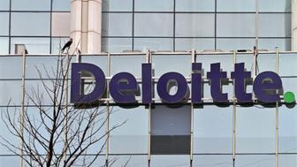 The Deloitte Company logo is seen on a commercial tower at Gurgaon, on the outskirts of New Delhi August 9, 2012. The Big Four accounting and consulting firms, Deloitte, Ernst & Young, KPMG and PwC, also are offshoring some audit work for U.S. companies to India, where salaries for accountants are a fraction of those in the United States. REUTERS/Parivartan Sharma (INDIA - Tags: BUSINESS LOGO EMPLOYMENT)