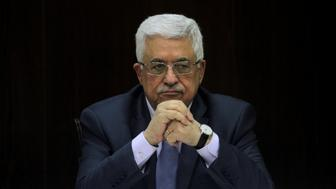Palestinian President Mahmoud Abbas heads a Palestinian cabinet meeting in the West Bank city of Ramallah July 28, 2013. REUTERS/Issam Rimawi/Pool/File Photo