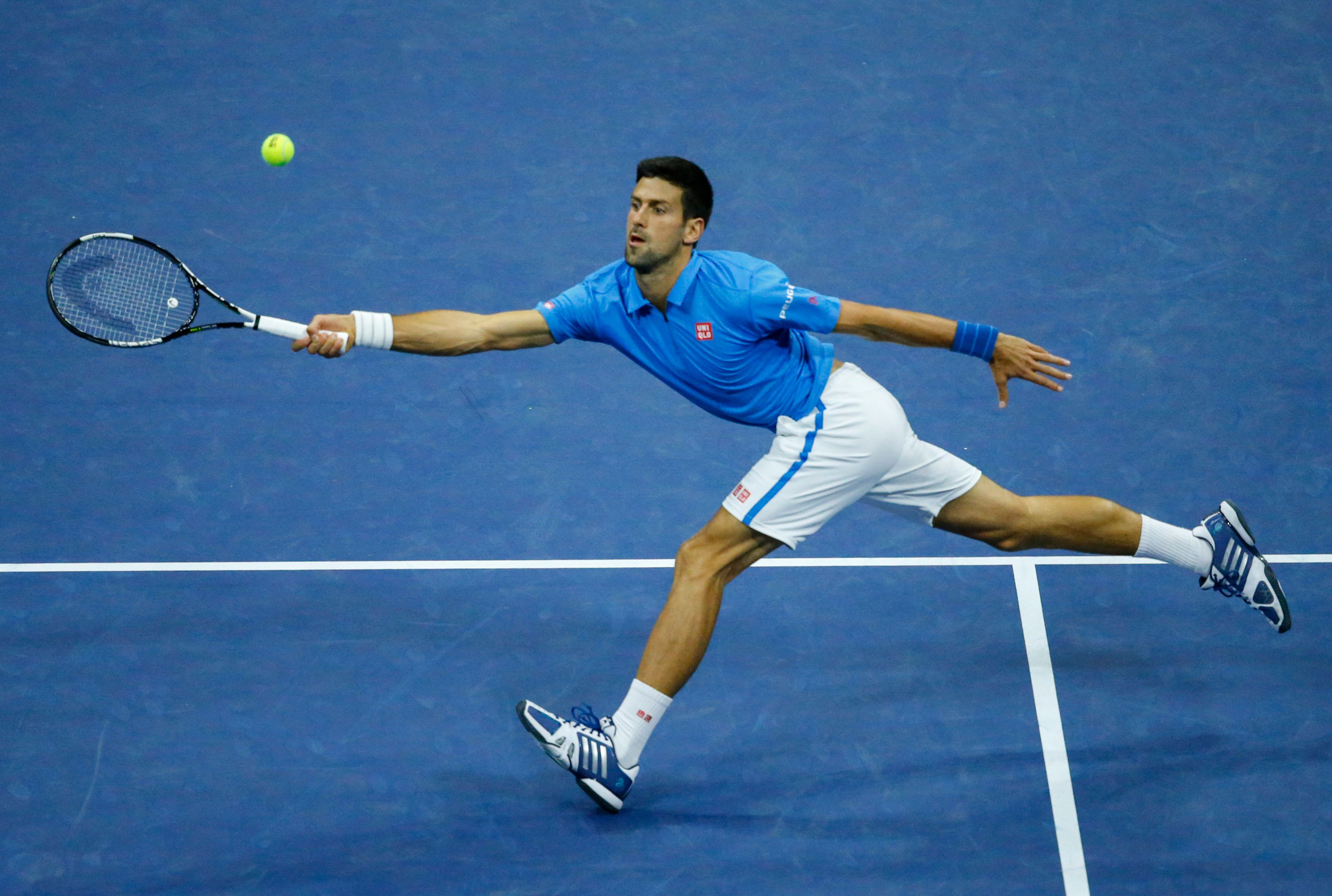 Novak Djokovic of Serbia hits a return against Jo-Wilfried Tsonga of France during their 2016 US Open Men's Singles match at the USTA Billie Jean King National Tennis Center in New York on September 6, 2016. / AFP / KENA BETANCUR        (Photo credit should read KENA BETANCUR/AFP/Getty Images)