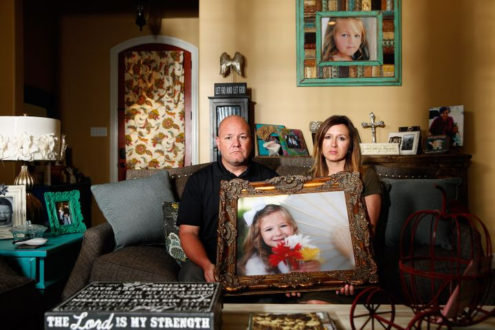 Kelly and Ryan Breaux sit holding a portrait of their deceased daughter Emma Breaux in their home in Breaux Bridge, Louisiana, on June 16, 2016. The husband and wife lost twins, Emma and Talon, to different superbugs that they contracted while in the neonatal unit at Lafayette General Hospital. U.S. Picture taken June 16, 2016.