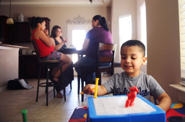 Kane plays with a toy at the home of his family in El Paso, Texas, U.S. on July 2, 2016. Kane's mother, Natalie Silva, contracted Methicillin-resistant Staphylococcus aureus, more commonly known as MRSA, a skin infection that can turn fatal once it enters the bloodstream, when she went to the hospital to give birth to Kane. After a 10 month battle with MRSA, Silva died, and her sisters have come together to raise her two children.