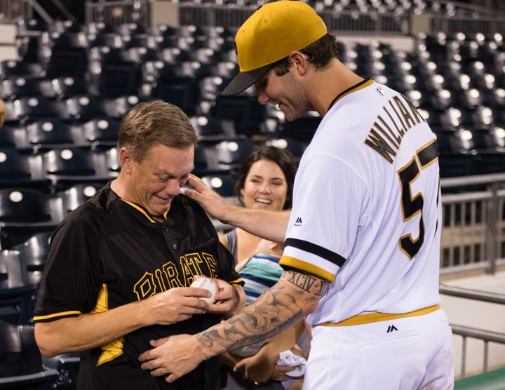 Trevor Williams' teary-eyed father, Richard Williams, is seen holding Wednesday's game ball as he celebrates with the Pirates