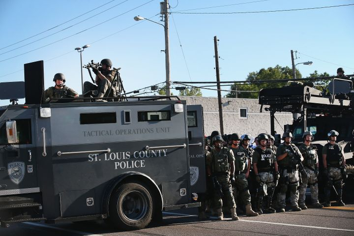 Police stand watch on Aug. 13, 2014, during the Ferguson protests.