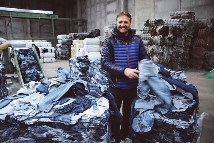 Bert van Son, CEO of Mud Jeans holding a pair of recycled denim.