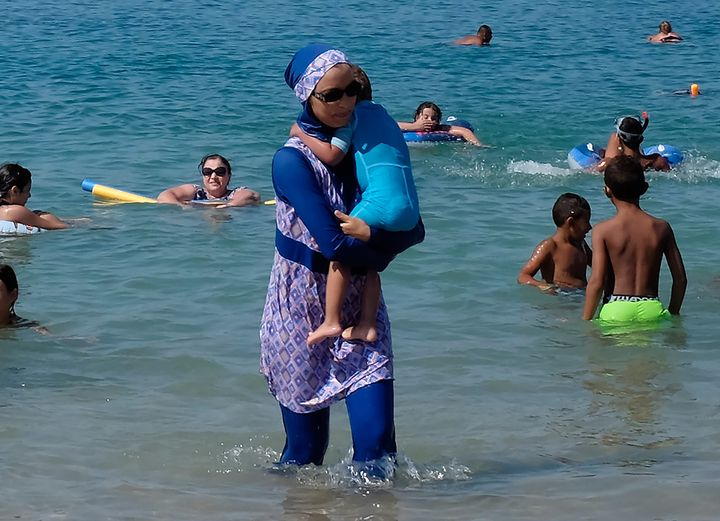 A woman wearing a burkini visits a beach in Marseille, France, on Aug. 27, 2016. France's heated debate o