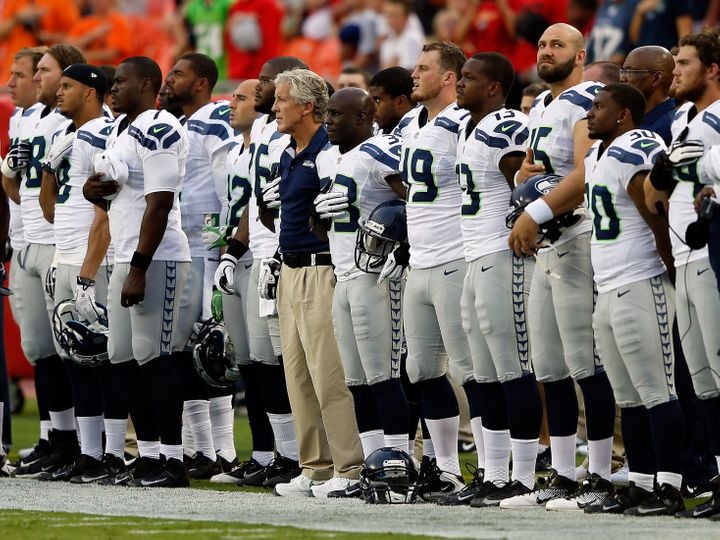 The Seahawks standfor the national anthem in 2012.