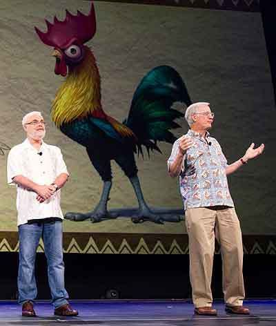 (L to R) Ron Clements and John Musker stand in front of an image of the earlier, smarter version of Heihei at last year's D23