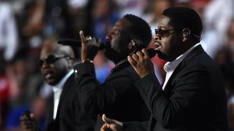 Boyz II Men perform during Day 1 of the Democratic National Convention at the Wells Fargo Center in Philadelphia, Pennsylvania, July 25, 2016. Die-hard Bernie Sanders supporters descended on Philadelphia for this week's Democratic National Convention, many so irate with party flagbearer Hillary Clinton that they are prepared to contemplate the once-inconceivable alternative: President Donald Trump. / AFP / Robyn BECK        (Photo credit should read ROBYN BECK/AFP/Getty Images)