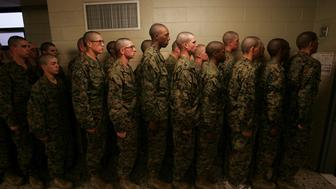 PARRIS ISLAND, SC - MARCH 07:  United States Marine Corps recruits line up before leaving the head (restroom) after making a 'head call' (restroom break) during boot camp March 7, 2007 at Parris Island, South Carolina. The Department of Defense has asked Congress to increase the size of the Marine Corps by 27,000 troops and the Army by 65,000 over the next five years.  (Photo by Scott Olson/Getty Images)