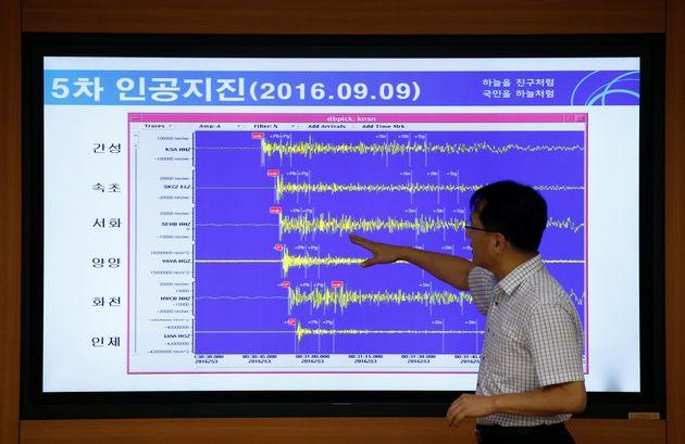 Ryoo Yong-gyu, Earthquake and Volcano Monitoring Division director, points at a chart showing seismic...