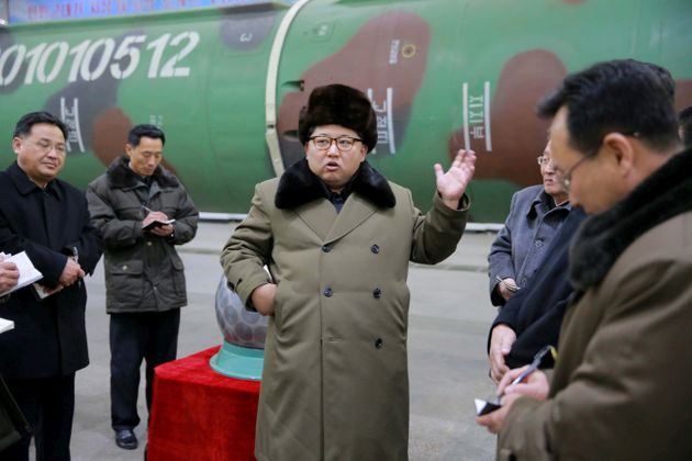 North Korean leader Kim Jong Un meets scientists and technicians in the field of research into nuclear...