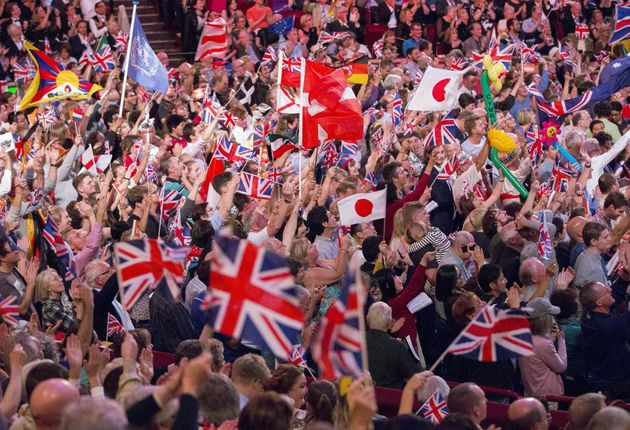 Revellers wave flags during the last night of the BBC Proms last