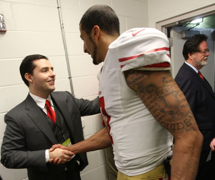 Jed York congratulates Colin Kaepernick in the locker room following agame against the Tampa Bay Buccaneers in201